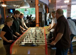Team playing foosball